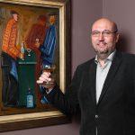 4_Tomáš Hejtmánek s obrazem U pultu Josefa Čapka připíjí na zdar aukce_foto Ivan Kahún_repro zdarma